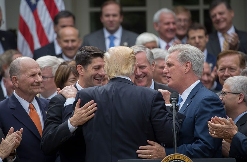 President Donald Trump is embraced by House Republican leaders as they came to the White House to celebrate.