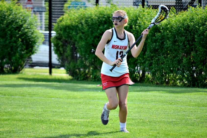 Niskayuna's Claudia Barbera heads toward the goal during Tuesday's Section II Class B lacrosse semifinal against Columbia.
