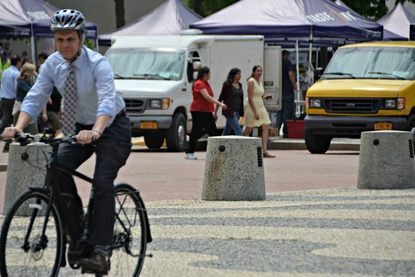 Assemblyman Angelo Santabarbara rides an e-bike at the Empire State Plaza on Wednesday.