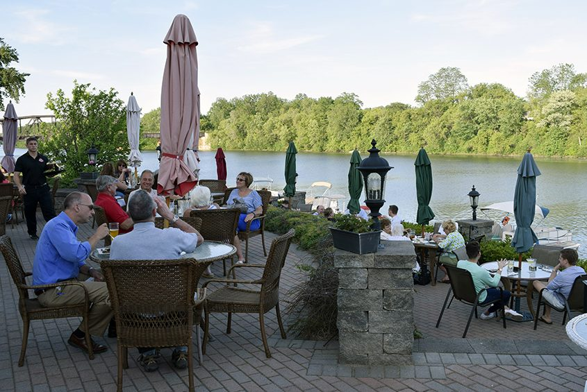 Outdoor dining and drinks at Water's Edge Lighthouse Restaurant in Glenville.