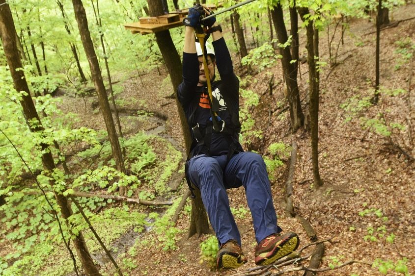 Gazette reporter Ned Campbell navigates the ropes course at Mountain Ridge Adventure in West Glenville.