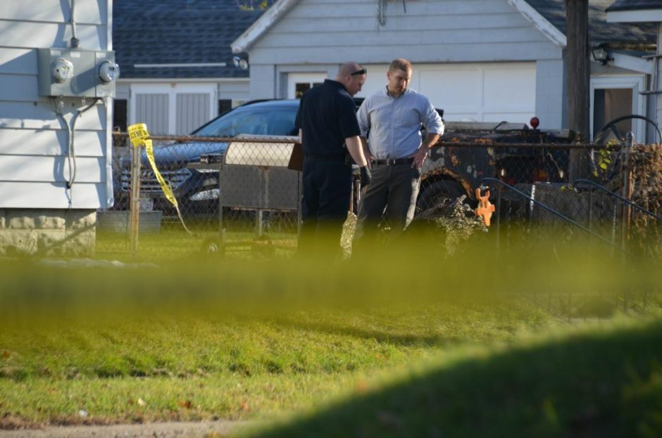 Investigators examine where police found the body of Charles Dembrosky, 49, dead of a gunshot wound to the head in Schenectady.