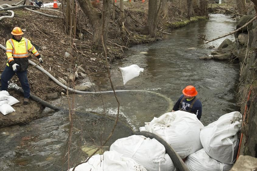 Workers construct a cofferdam on the Cayadutta Creek in Gloversville on April 25, 2017.