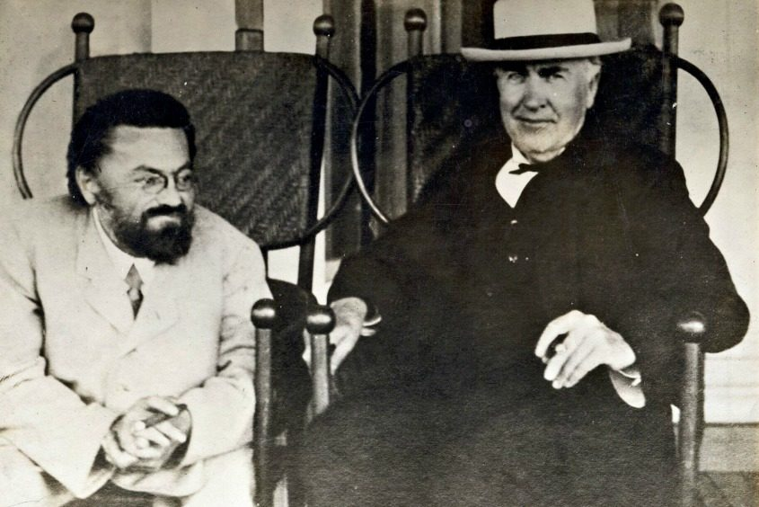 Charles Steinmetz and Thomas Edison each enjoy a cigar as they take a short respite from a tour of the GE plant in 1922.