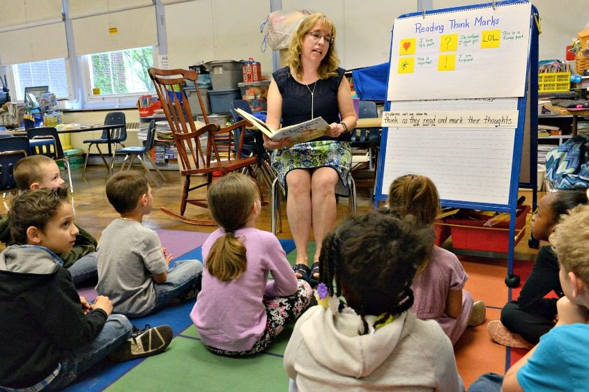 Van Corlear Elementary teacher Sharon Eddy reads and asks questions of her students.