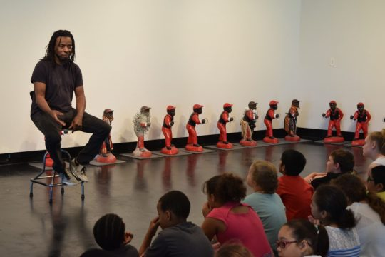 Artist Willie Cole talks with Hamilton Elementary students about his life and his work.