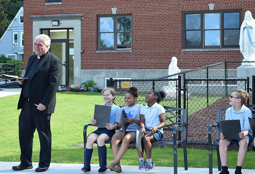Father Bob Longobucco at the blessing and dedication of St. Kateri Tekakwitha's early childhood education center.