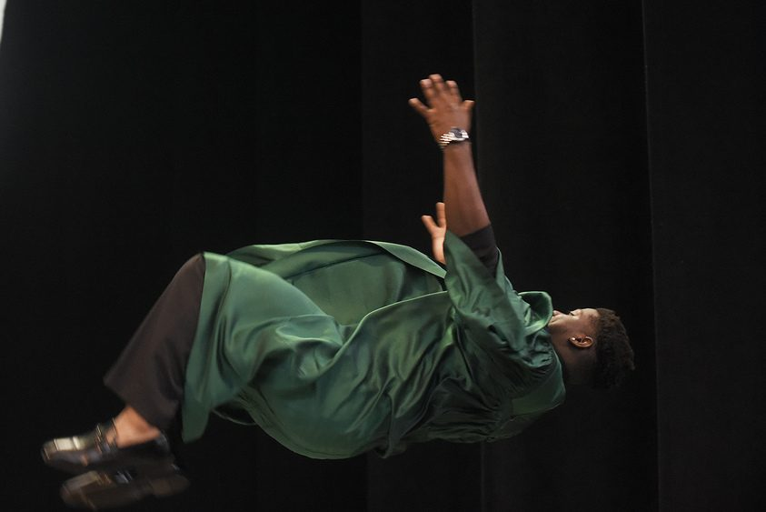 Shenendehowa graduate Alexander Locke does a back flip on stage before receiving his diploma Friday.