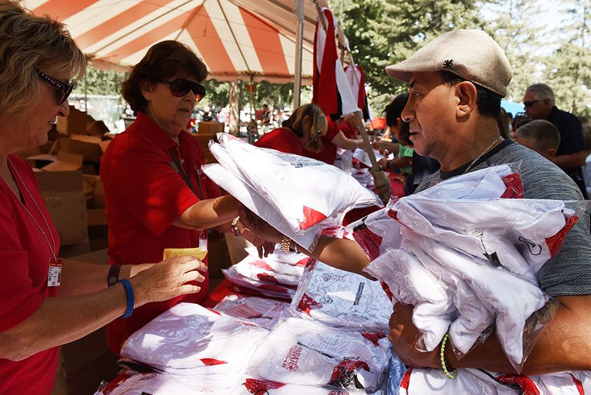 Patrons pick up giveaway shirts at Saratoga Race Course on Sept. 4, 2016.
