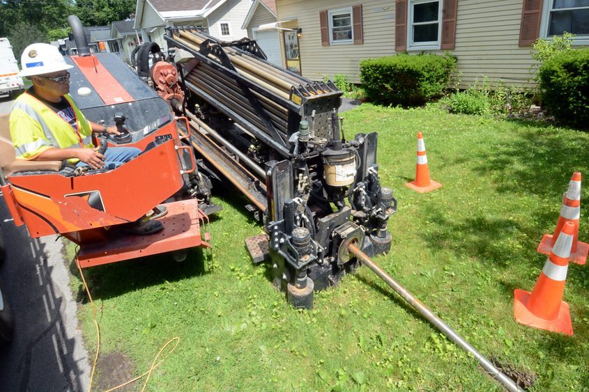 John Slattery operates machinery last week on Engleman Avenue in Scotia.