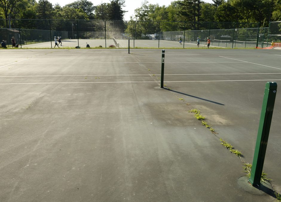 Some of the tennis courts at Central Park await repairs.