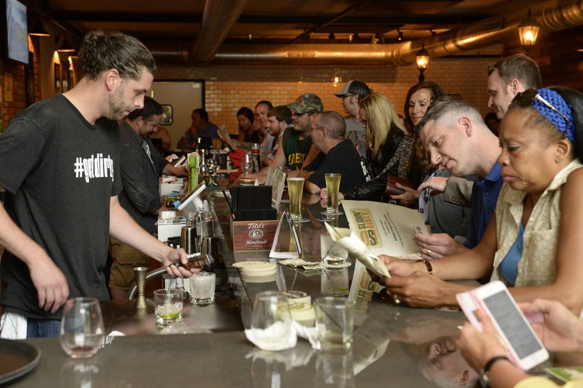 The bar is full at Slidin' Dirty at 512 State St. during its grand opening Thursday, June 29, 2017.