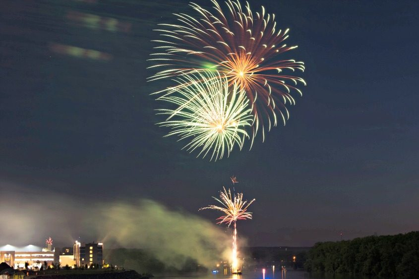 Fireworks illuminate the Mohawk River as they're launched from a barge near the Rivers Casino and Resort on Monday.