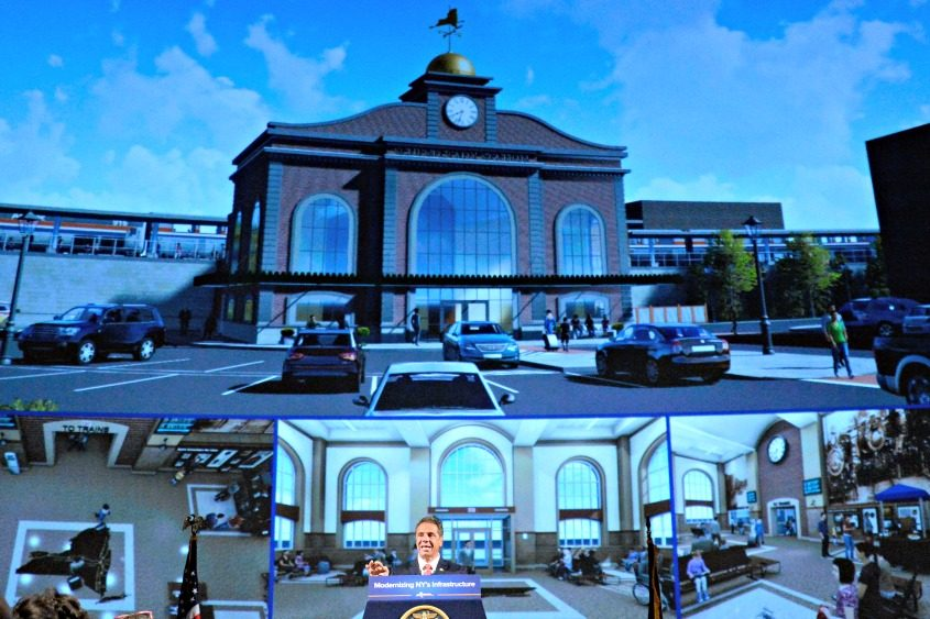 Gov. Andrew Cuomo speaks Tuesday with a rendering of the new Schenectady train station projected behind him.