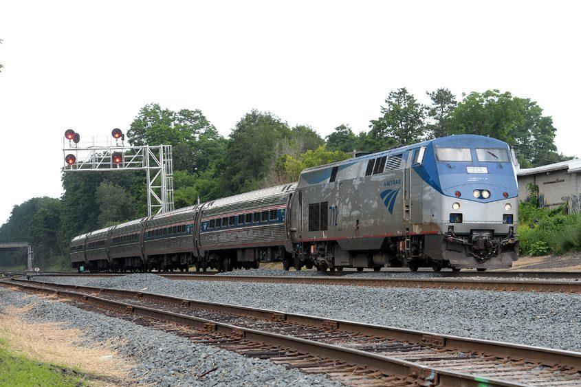 An Amtrak passenger train moves westbound on the new line near Chrisler Avenue on Wednesday.