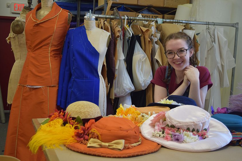 "Grace White with some of the hats she helped create for Park Playhouse's production of ""The Music Man."""