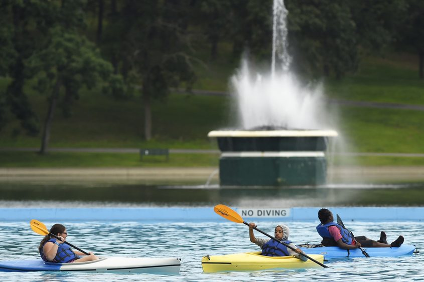 Campers kayak in the swimming pool in Schenectady's Central Park.