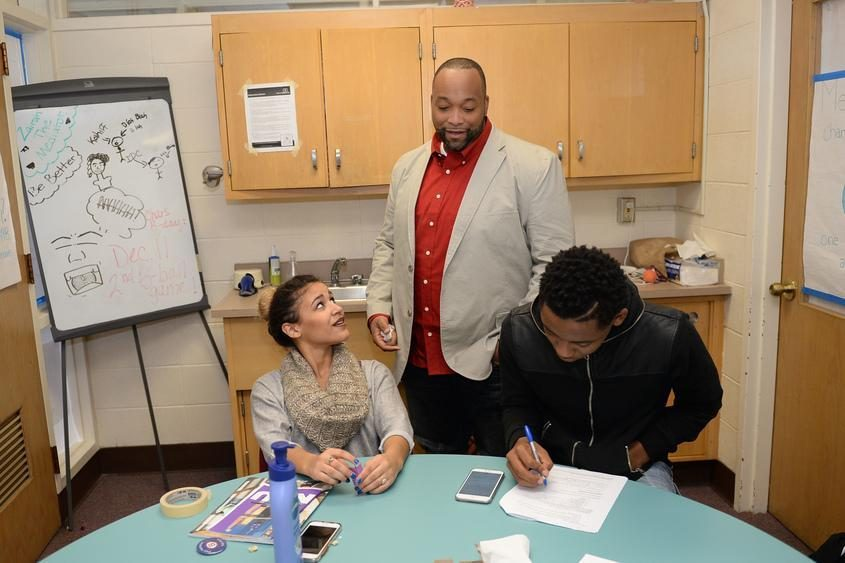 Damonni Farley meets with peer mediation students at Schenectady High School in November 2015.