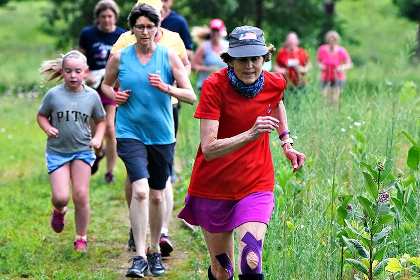 Laura Clark competes in a Saratoga Stryders 5K trail fun run at Wilton Wildlife Preserve in June.