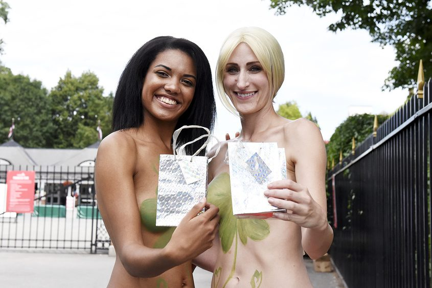 Alice (left) and Sara stand topless last week outside the Saratoga Race Course.