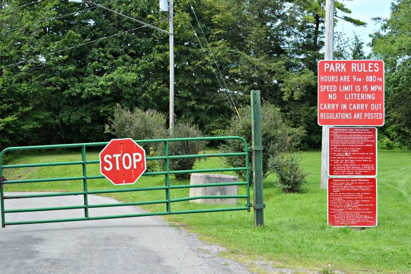 A padlocked gate warns visitors that Wintergreen Park, which runs alongside Canajoharie Creek, is closed.