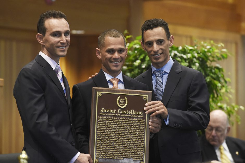 Javier Castellano, center, poses for pictures with fellow Hall of Famers Ramon Dominguez, left, and John Velazquez.