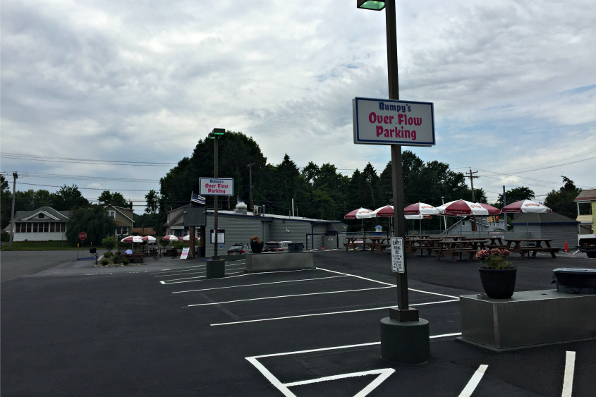 A freshly paved lot with 15 to 20 new parking spaces was added after Hoffman Car Wash was demolished.