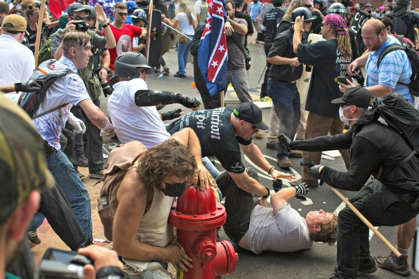 Fighting in the streets of Charlottesville, Va., on Aug. 12, 2017.