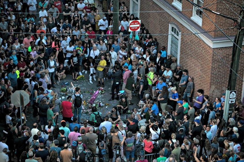 A vigil at the site where on Saturday a car plowed into a group of counterprotesters.