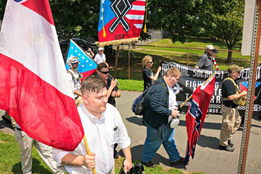 """White nationalists march in the """"Unite the Right"""" rally in Charlottesville, Va., on Aug. 12, 2017."""