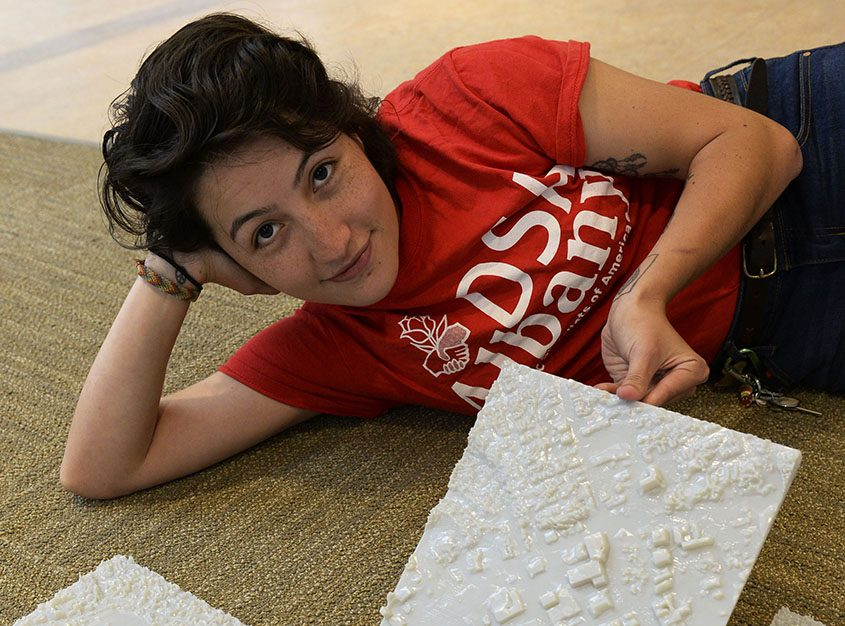 Union College graduate Sonia Sandoval with a three-dimensional map of the Union College campus and Schenectady on Thursday.