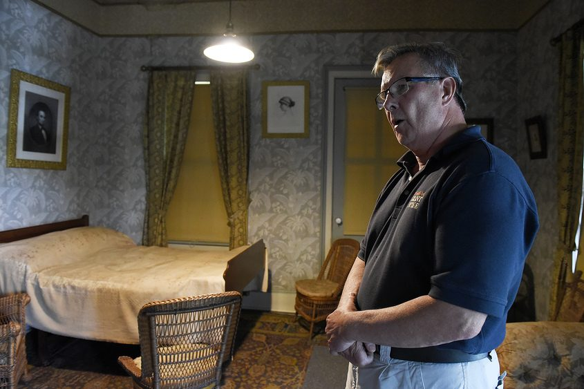 Tim Welch, president of the Friends of Grant Cottage, describes the interior.