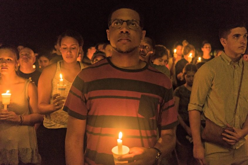 People gather for a candlelight vigil on the University of Virginia campus in Charlottesville, Va., on Aug. 16, 2017.