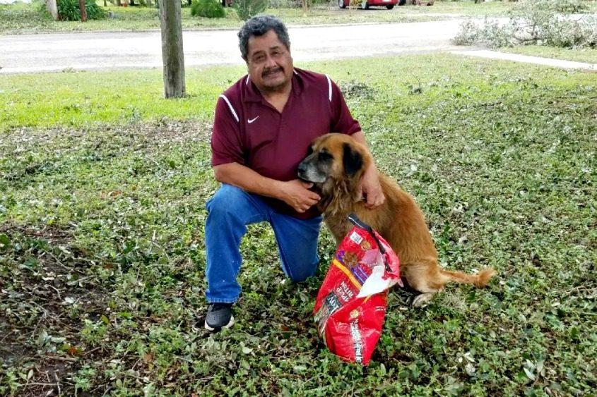 Salvador Segovia and Otis pose outside Segovia's home in Stinton, Texas, on Saturday.