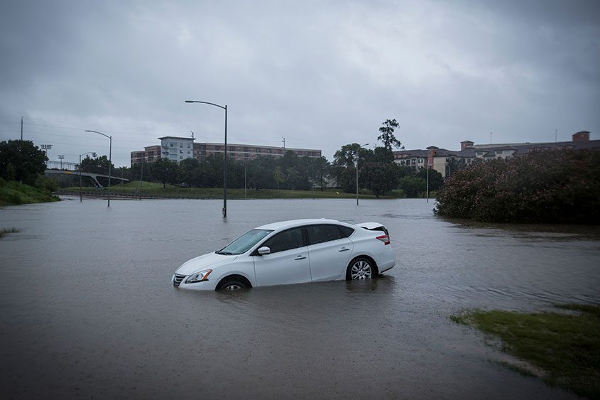 An abandoned car during flooding in Houston, Aug. 29, 2017.