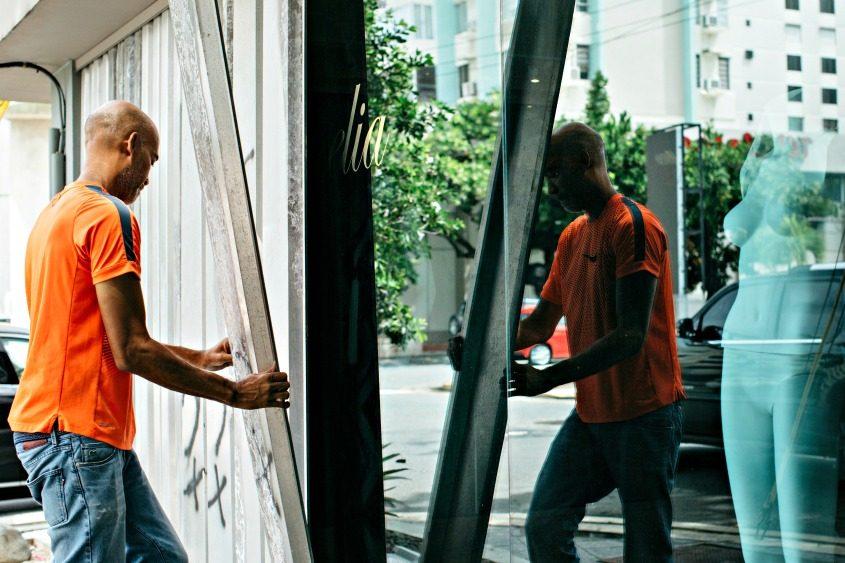 Ellis Cerda puts up storm shutters at a boutique in San Juan, Puerto Rico.