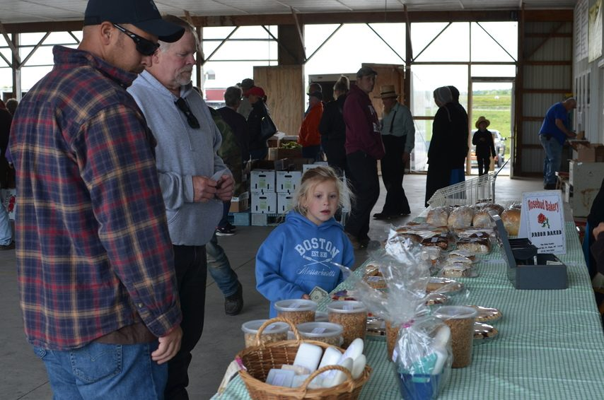 Dan Ross and granddaughter Kali Krutz pick out a treat from Rosebud Bakery at the Mohawk Valley Produce Auction.