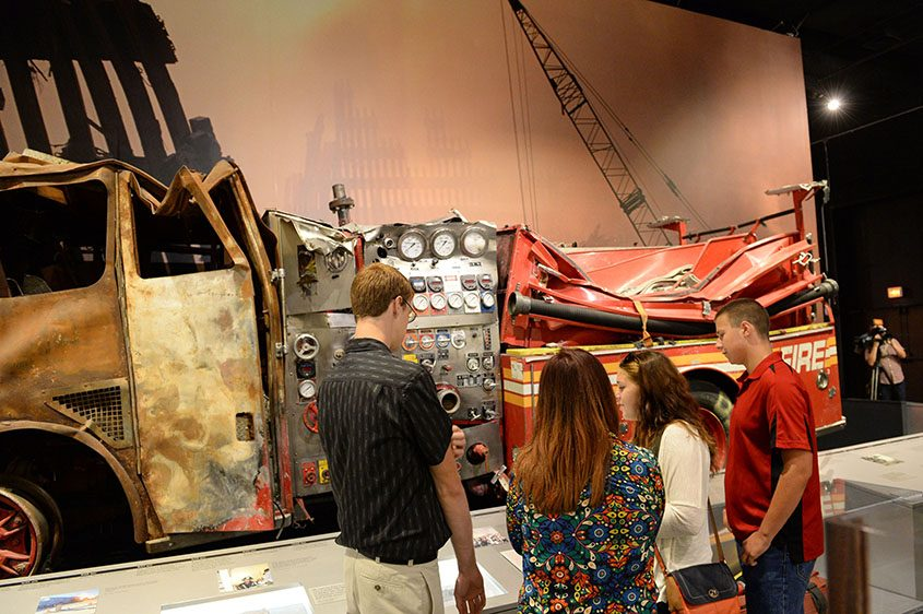 Students visit the 9/11 exhibit inside the New York State Museum in Albany.
