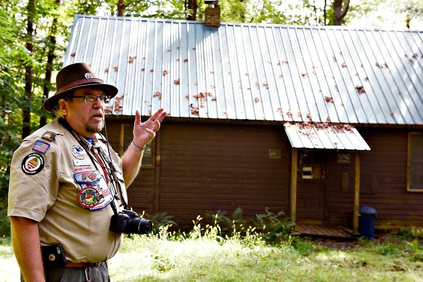 John Papp, a Boyhaven patriarch who first set foot on the grounds in 1973, gives a tour of the camp Saturday.