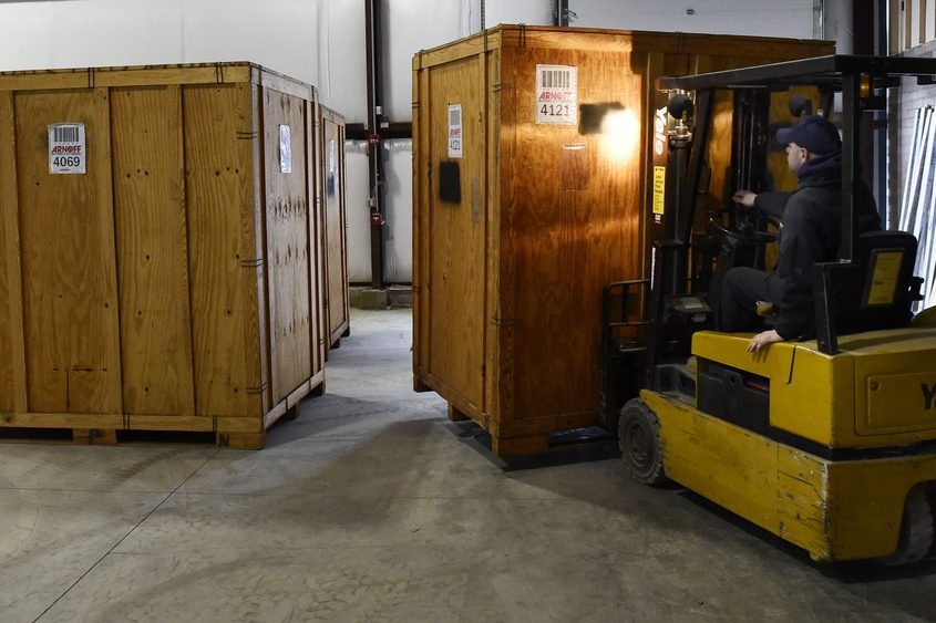 A forklift operator moves a storage crate at Arnoff Moving & Storage in Malta in February.