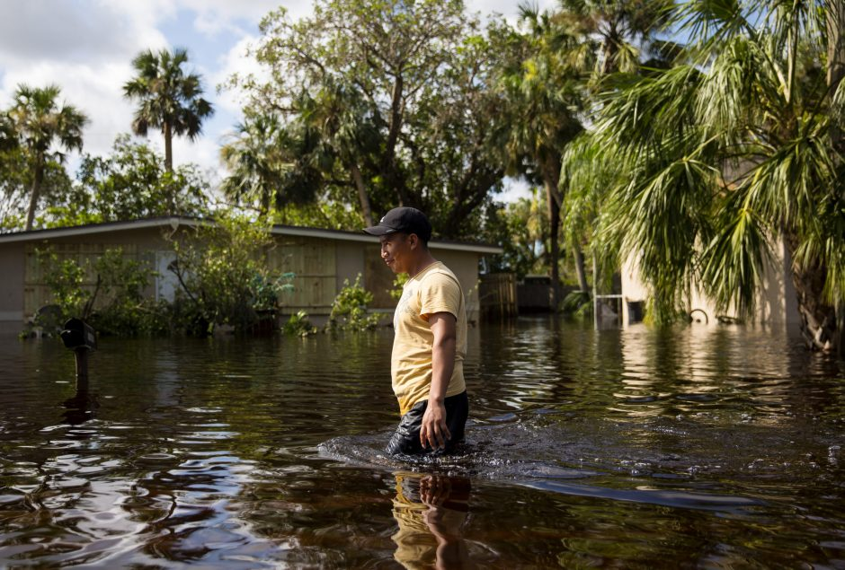A resident wades through floodwaters in a neighborhood in Bonita Springs, Fla., on Sept. 12, 2017.