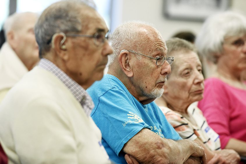 Constituents listen as the panel members speak at a community forum on senior issues Monday.