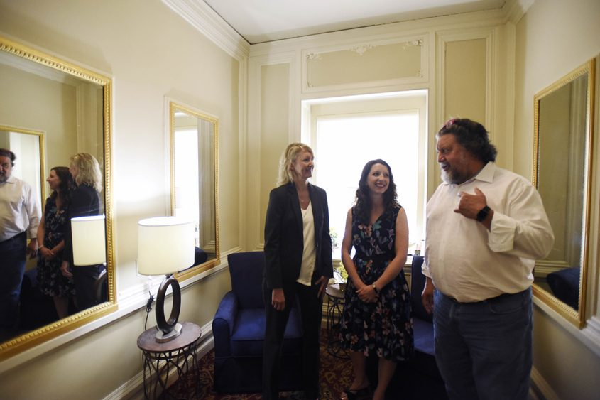 Holly Brown (from left), Erin Sinisgalli and Philip Morris check out the new lactation room Monday at Proctors.