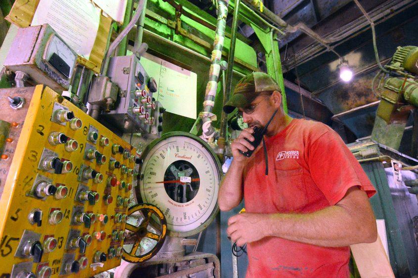 Mark Zimcik radios the grain silo at the Central Bridge feed mill.