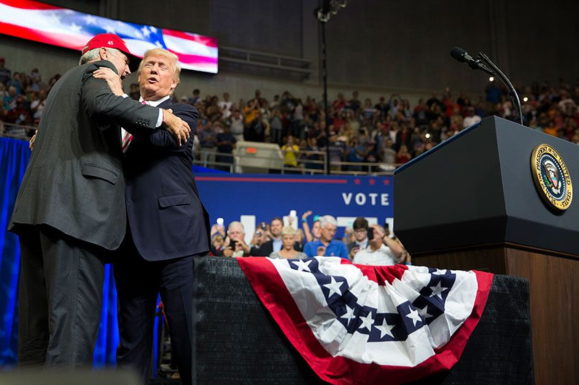 President Donald Trump greets Sen. Luther Strange during a campaign rally for Strange in Huntsville, Ala., on Sept. 22, 2017.