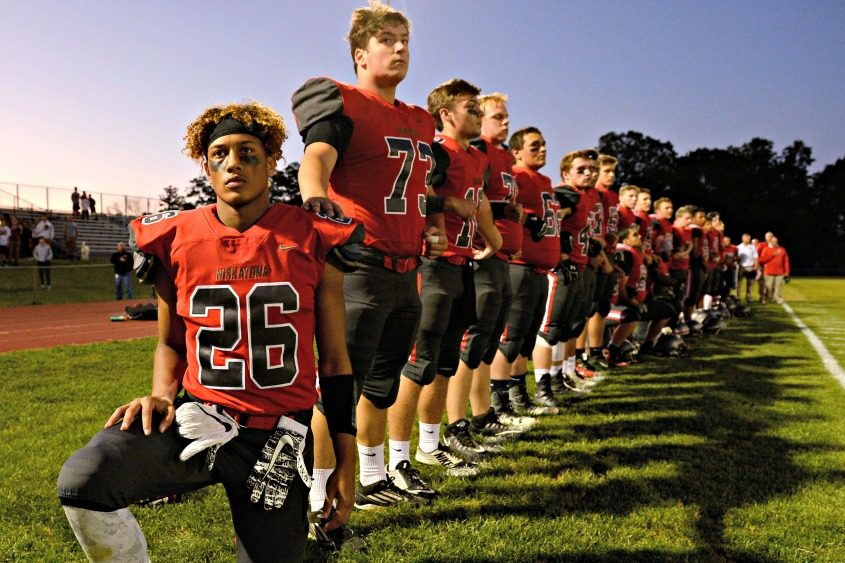 Niskayuna wide receiver Ismail Stewart takes a knee Thursday during the national anthem.