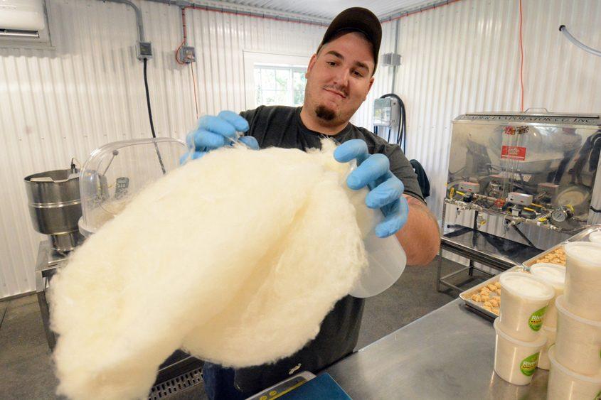 Riverside Maple Farms employee Corey Kieru makes maple cotton candy.