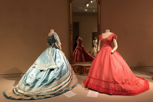 The ball gown at right was designed by Emile Pingat in 1867, silk faille and tulle trimmed with beads and seed pearls.