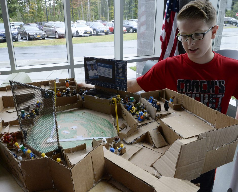 Pinewood School student Connor McCarthy with his replica of Yankee Stadium.