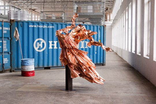 """A bright copper sculpture resembles a windblown dress in the MASS MoCA exhibit """"The Archeology of Another Possible Future."""""""